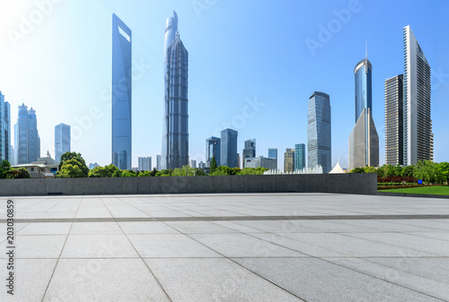 Plakat modern city commercial office buildings and empty square floors in Shanghai