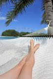 POV of a woman lay on a hammock relaxing in Muri lagoon in Rarotonga Cook Islands - 203039270
