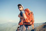 Portrait of backpacker posing in the mountains - 203043474