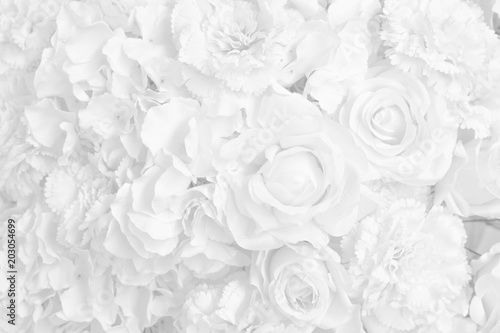 Beautiful decoration artificial rose flower in white tone background.