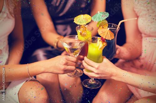 Female friends toasting...