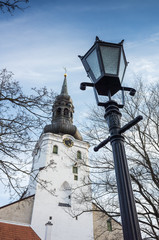 Tallinn old town, street light with tall church