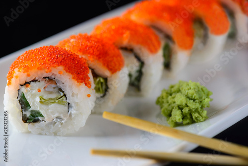 Fotobehang Sushi bar sushi rolls with red caviar on a white plate