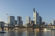 panoramic view of skyline of Frankfurt with old iron foot bridge