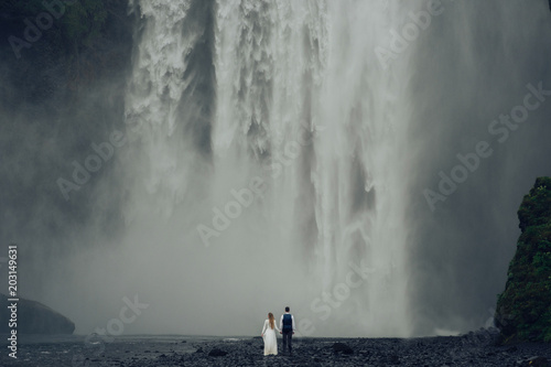 Happy stylish smiling couple walking and kissing in Iceland , on - 203149631