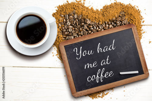 Poster White cup of coffee against chalkboard with piece of chalk