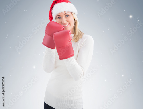 Festive blonde in boxing gloves on vignette background