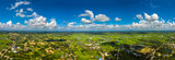 Panorama Top view Aerial photo from flying drone over village in Thailand.Top view beautiful Sunset.Sunrise with cloud over rice field.