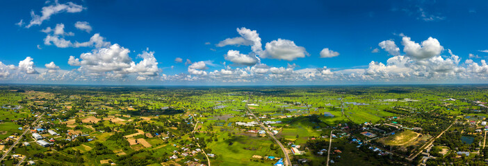 Panorama Top view Aerial photo from flying drone over village in Thailand.Top view beautiful Sunset.Sunrise with cloud over rice field. © noon@photo