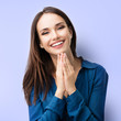 Happy gesturing smiling young woman