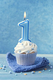 Cupcake with a blue candle