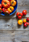 vegan display of different cracked heirloom tomatoes, copy space wallpaper - 203213607