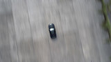 Sports car racing in motion blur – abstract background - top air view from above