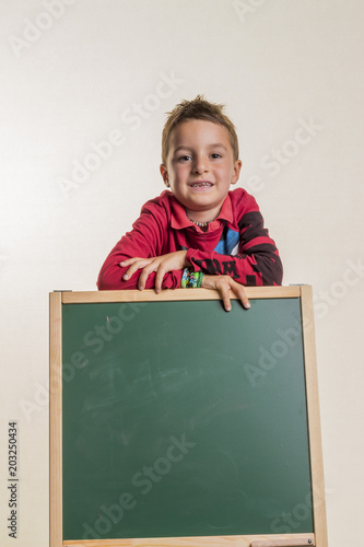 schoolchild with school blackboard