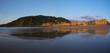 The city of San Sebastian (Donostia) reflected in the beach of la zurriola at sunset.