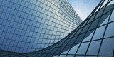 View of the clouds reflected in the curve glass office building. 3d rendering - 203267664