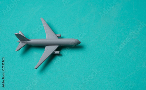 Gray Miniature toy airplane on blue background