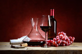 Red wine glass with bunch of grapes and decanter - 203298212