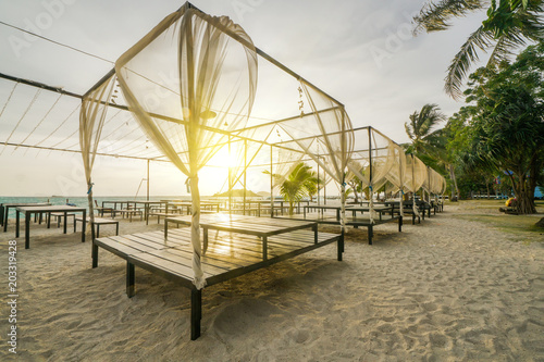 Plexiglas Strand Beach bed with sunrise flare in morning time.