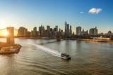 Panoramic view of Brooklyn bridge and Manhattan at sunset, New York City - 203335018