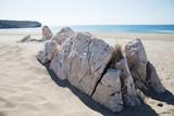 white rocks on sandy beach and beautiful seascape at sunny day, patara beach, turkey