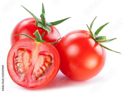 Two cherry tomatoes and a cross section of tomato. White background.