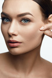 Elastic Skin. Woman With Beautiful Face.