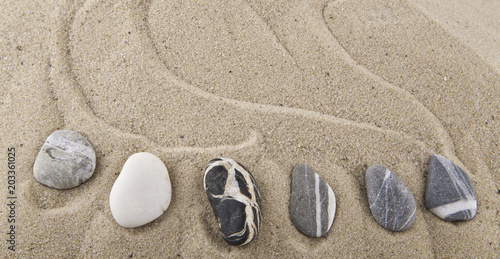 stones on sand for relaxation as background © Valerii Zan