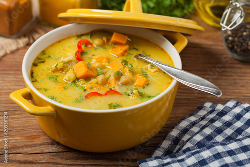 Foto Murales Sweet potato soup with chicken and lentils.