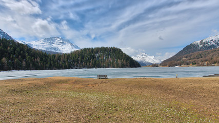 Mountain landscape in the Engadine valley near Sankt Moritz. At spring thaw