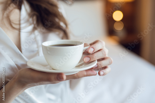 Young woman with a cup © AboutLife