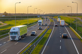 evening traffic of cars on the Polish expressway - 203379419