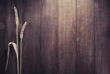 ears of wheat on wood