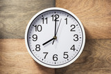 wall clock at wooden background - 203383473