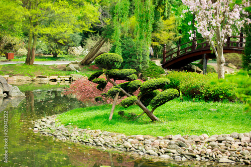 Fridge magnet Beautiful japanese garden and pond in spring time.