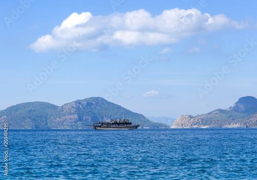 Boats over calm sea in blue lagoon in Turkey