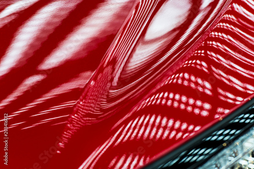 Abstraction of red metal surface of a modern car hood - 203416012