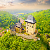 Aerial view to The Karlstejn castle. Royal palace founded King Charles IV. Amazing gothic monument in Czech Republic, Europe. - 203434830