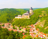 Aerial view to The Karlstejn castle. Royal palace founded King Charles IV. Amazing gothic monument in Czech Republic, Europe. - 203434890