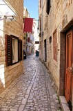 Pretty medieval lane in the old town of Trogir, Croatia - 203435458