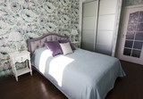 Bedroom in Provence style in blue and lilac colors bright modern interior