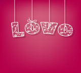 the word love written in a lace print. pink background.