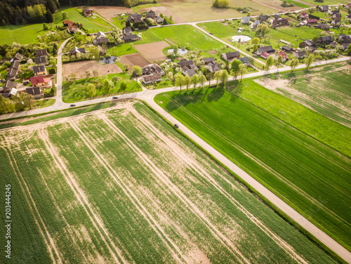 Plexiglas Pistache Farmers Prepare to plant their crops for further cultivation. Aerial view on the field after tractor signs. Green field in spring.