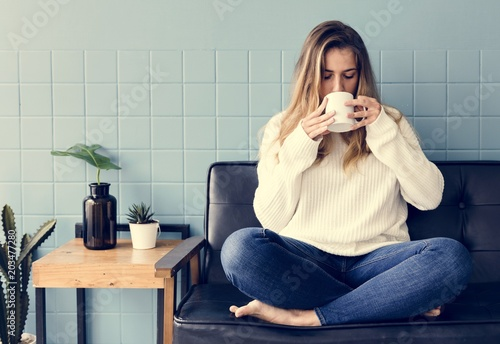 Poster A Caucasian Woman Sitting and Drinking Coffee