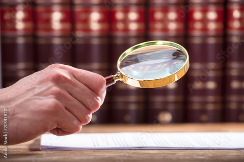 Fototapeta Human Hand Examining Document