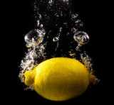 Lemon in water on a black background