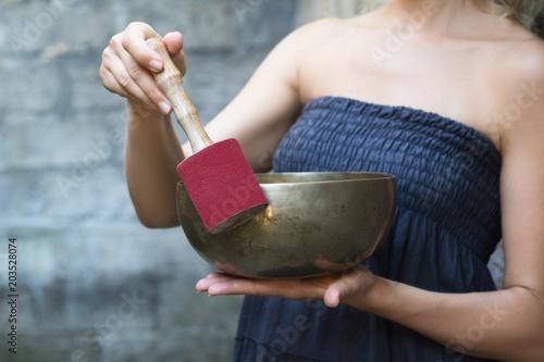 Fototapeta Tibetan singing bowl in the hands of a woman