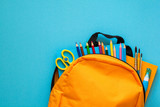 Back to school concept. Backpack with school supplies. Top view. Copy space - 203541447