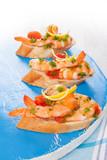 Mediterranean seafood eating.