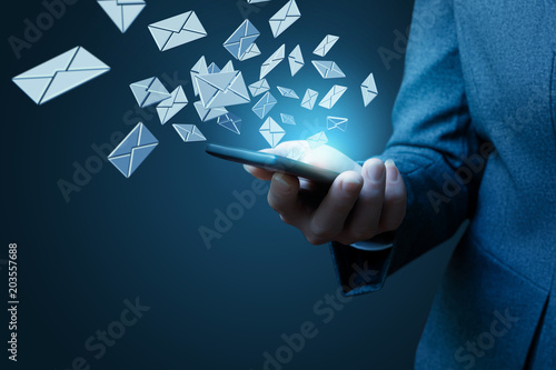 Fototapeta Businesswoman works with emails.
